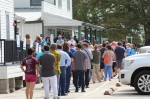 Voters line up outside Juergen's Hall Community Center in Cypress on Oct. 14. (Shawn Arrajj/Community Impact Newspaper)
