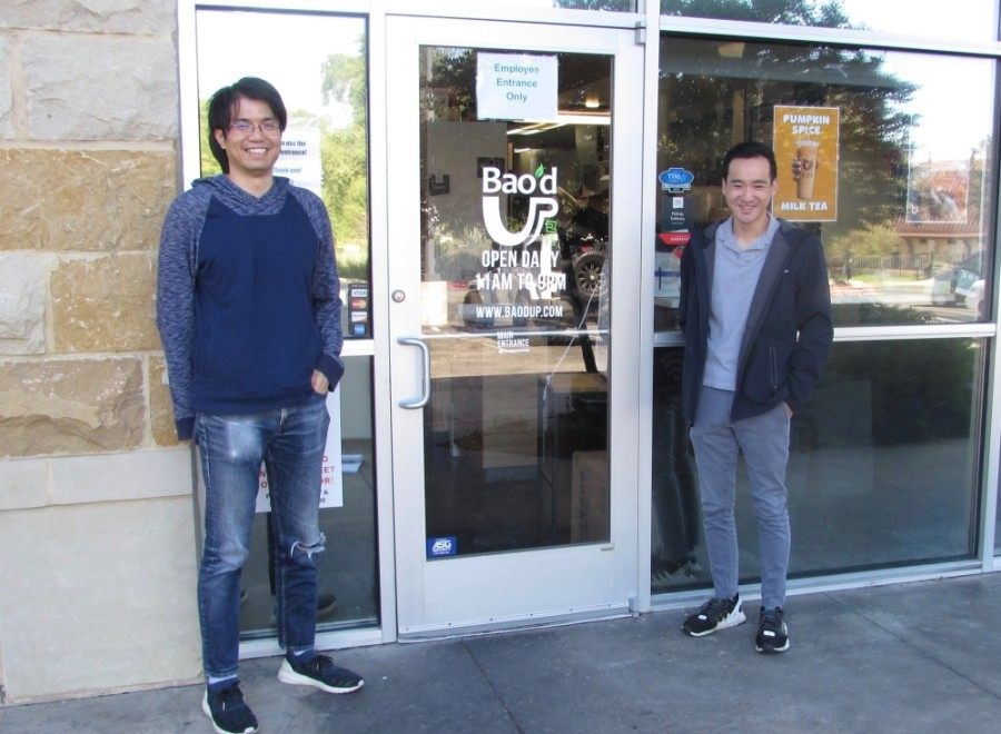 Alex Wu (left) and Kevin Tran stand, social distanced, outside of Bao'd Up in Sunset Valley. (Nicholas Cicale/Community Impact Newspaper)