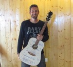Scott Friedeck, owner of The Graphic Guitar Guys, started working with guitars in 2011. (Nicholas Cicale/Community Impact Newspaper)