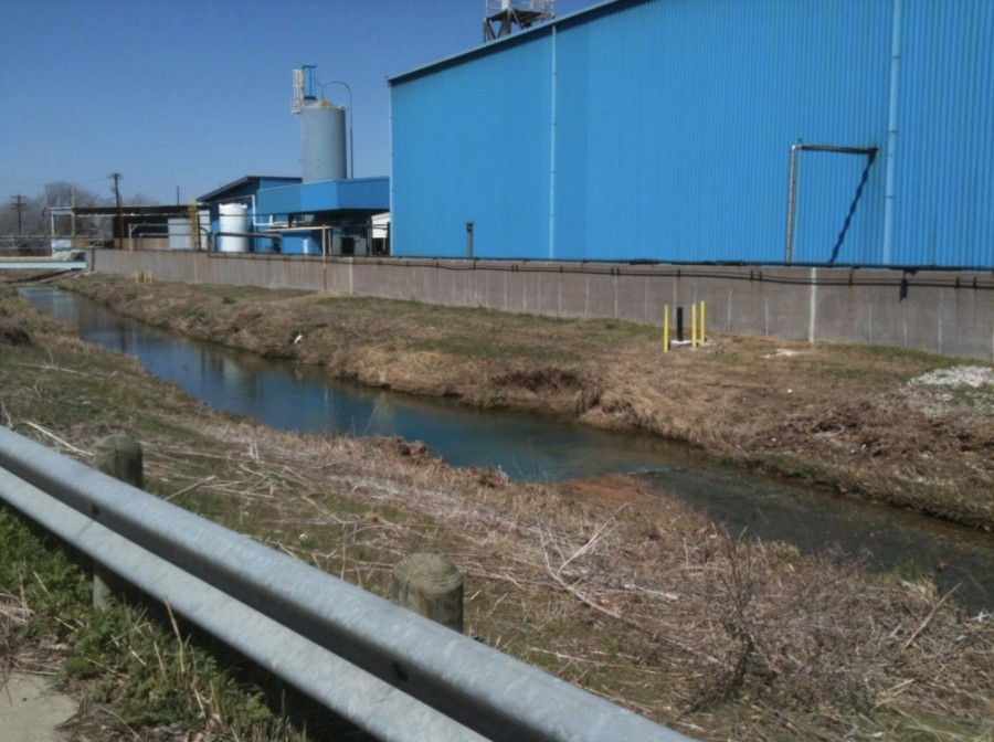 Exide Technologies' battery recycling plant operations were located right next to Stewart Creek, as seen in this 2013 photo. All of the buildings at the site have since been taken down, but contamination of the site remains. (Courtesy Exide Technologies)