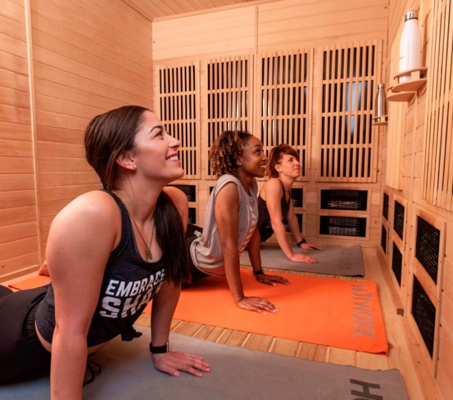 The new studio offers 24-hour access to virtually instructed infrared sauna workouts, from hot yoga and hot Pilates to hot barre and hot cycle. (Courtesy HOTWORX)