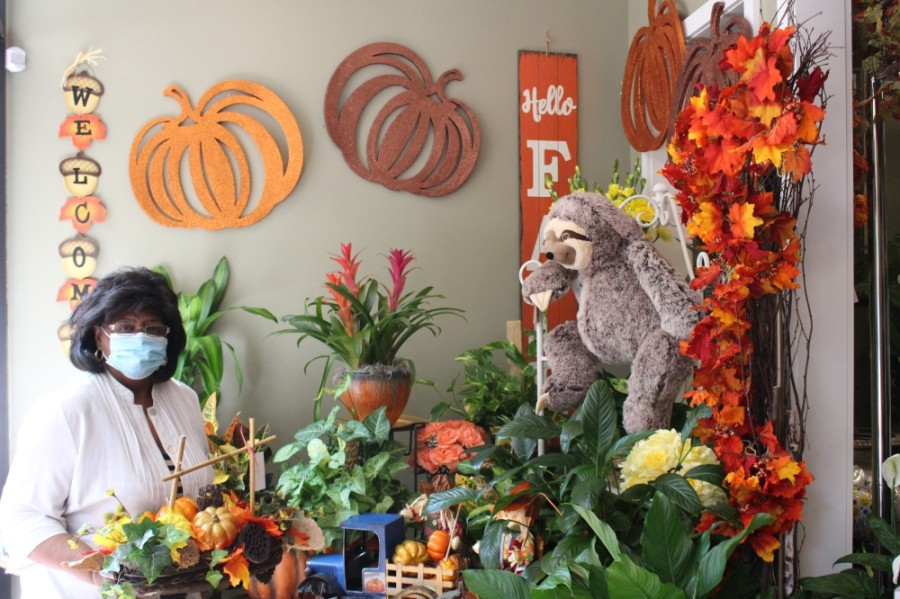 House of Blooms owner Pat Houck showcases her fall arrangements in the flower shop's front entrance. (Claire Shoop/Community Impact Newspaper)