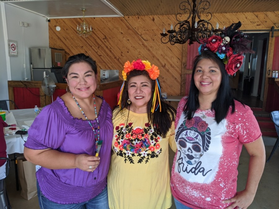 From left: Tanya Perez, Mary Ann Labowski and Shelley Bujnoch gathered for the Día de los Muertos painting party. (Lauren Canterberry/Community Impact Newspaper)