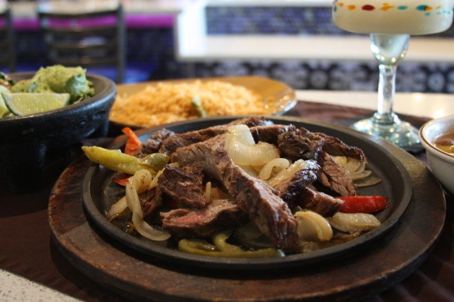 Sizzling Fajitas  st Adobe Cafe are $15.99 for one person and $28.99 for two people. (Lauren Canterberry/Community Impact Newspaper)