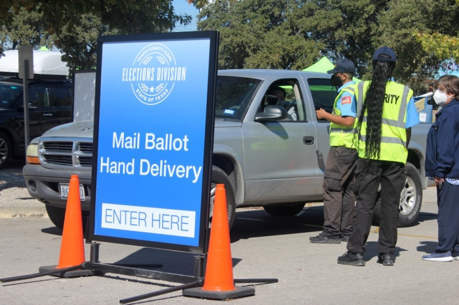 Travis County residents hand-deliver their ballots to election officials on Nov. 3.