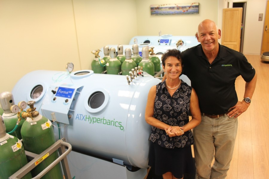 Co-owners Dr. Eleanor and Clay Womack stand among their four hyperbaric chambers in their West Lake Hills Clinic. (Photos by Brian Perdue/Community Impact Newspaper)