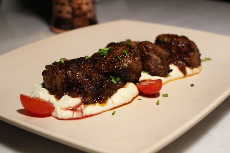Beef tenderloin tips are served over goat cheese with caramelized onions and fresh tomatoes. $12.99. (Andrew Christman/Community Impact Newspaper)
