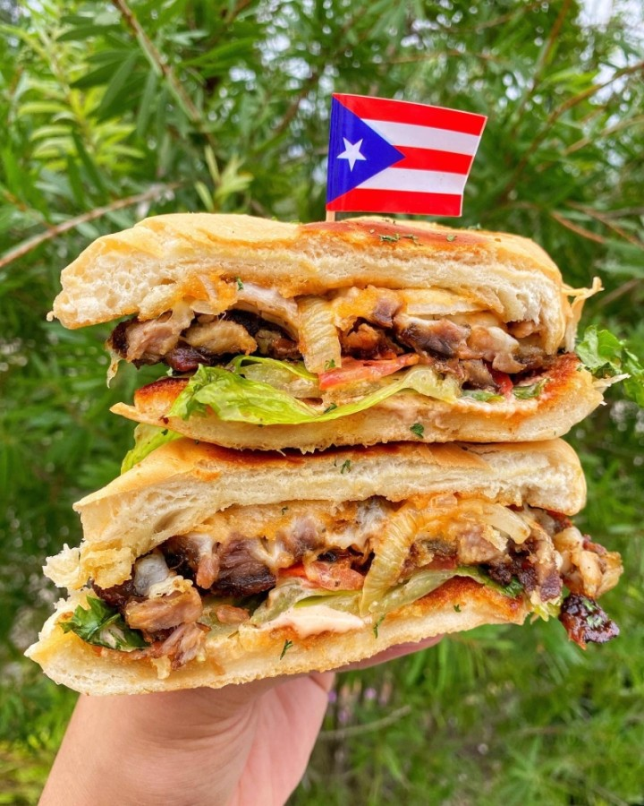 The eatery specializes in authentic Puerto Rican cuisine, from fresh, handcrafted empanadillas and loaded tostones to fried green plantains and ceviche. (Courtesy El Caribeno)
