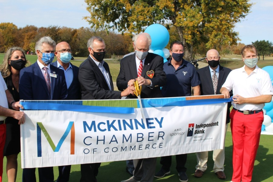 Officials with the Salesmanship Club of Dallas and the McKinney Chamber of Commerce cut the ribbon on the AT&T Byron Nelson Tournament's planned move to TPC Craig Ranch in McKinney. (William C. Wadsack/Community Impact Newspaper)