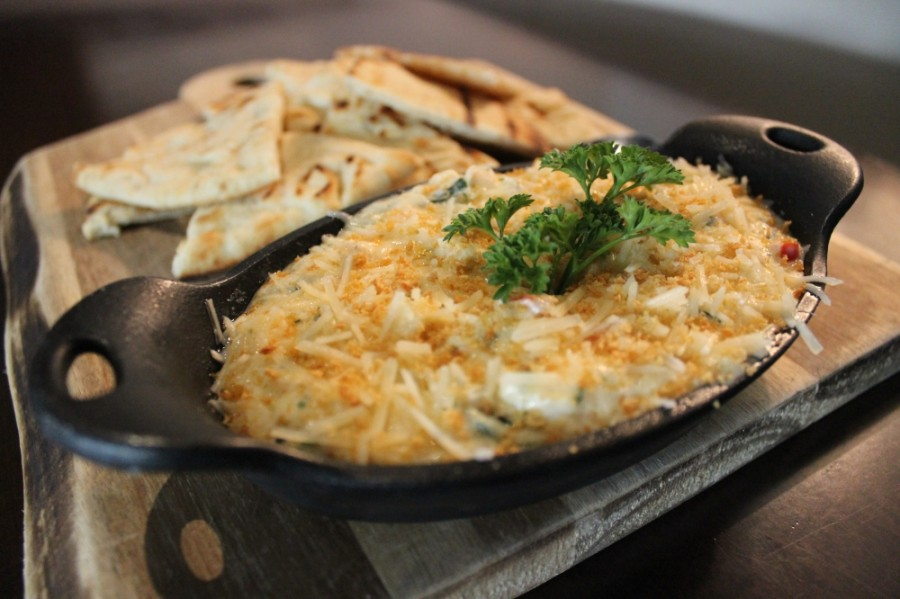 The hot crab and shrimp dip at Hillside Fine Grill is baked until bubbly, then served with pita bread. (Daniel Houston/Community Impact Newspaper)