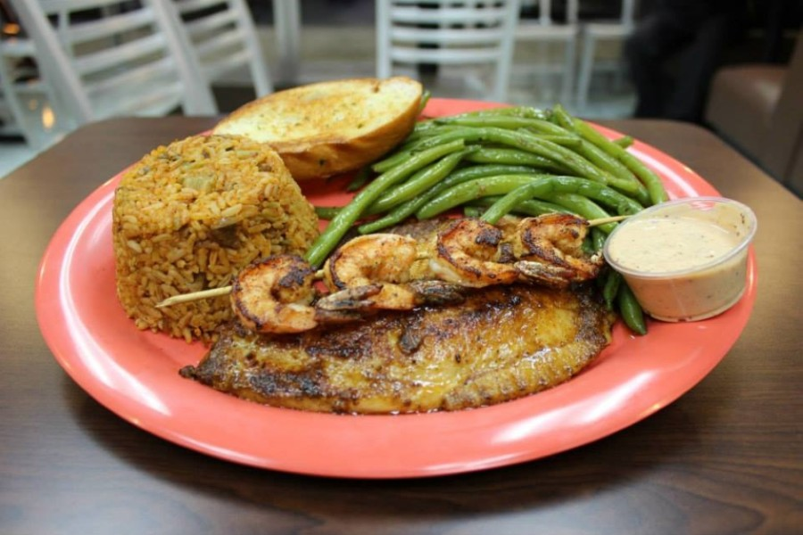 Soon to be located at 18252 FM 1488, Magnolia, Louisiana Fish House offers a variety of seafood dishes such as the blackened red fish and shrimp. (Courtesy Louisiana Fish House)
