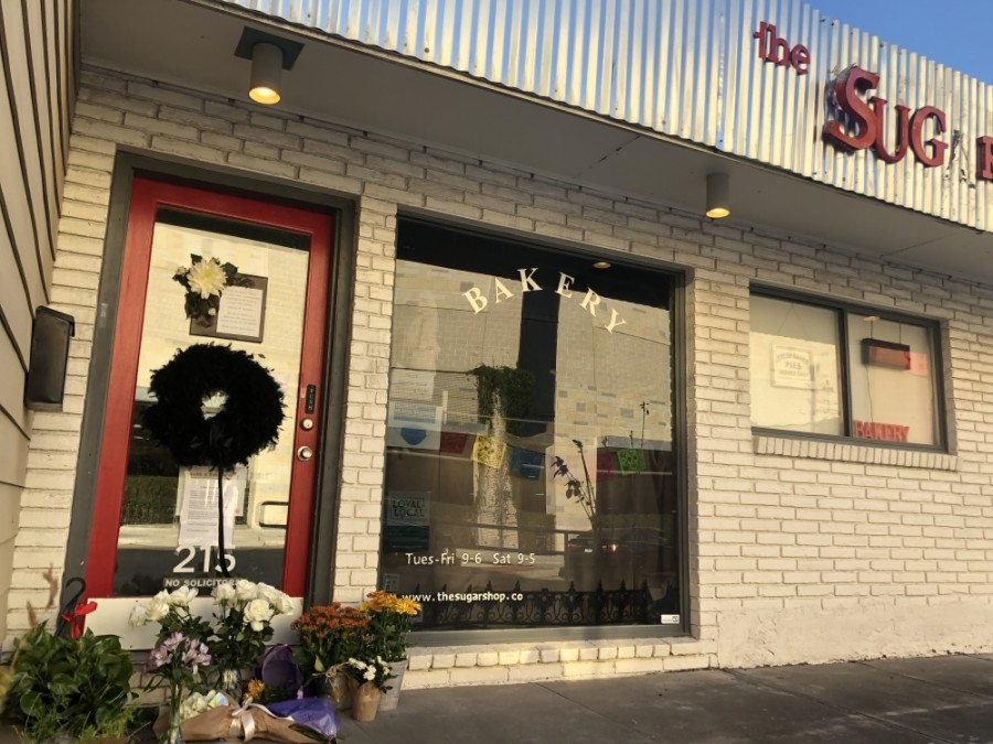 Those who remember Nathan Maynor, owner of Bellaire Sugar Shop Bakery & Gifts, have erected a memorial outside his bakery. (Matt Dulin/Community Impact Newspaper)