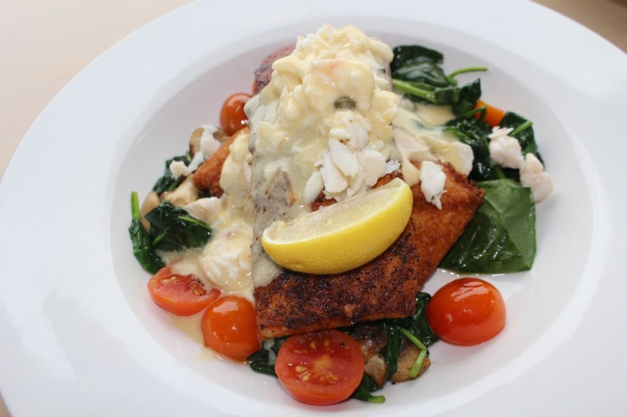 The Crabby Salmon ($32.99) is topped with blue crab and lemon butter sauce. (Eva Vigh/Community Impact Newspaper)