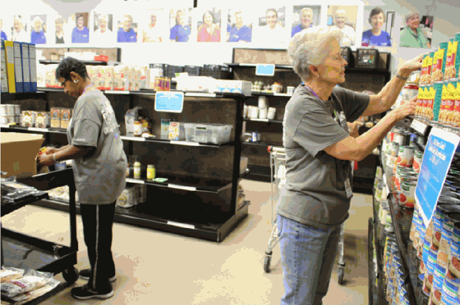 Volunteers help with a variety of tasks, from filling food pantry orders to sorting items in the Clothing Closet. (Olivia Lueckemeyer/Community Impact Newspaper)