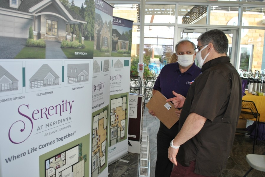 Gracemark Homes CEO Adrian Jacob visits with a potential customer at the pre-sales event. (Courtesy Kaplan Public Relations)