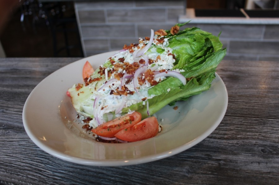 The Romaine Wedge Salad ($7.25) consists of romaine lettuce, hickory smoked bacon, red onions, tomato, blue cheese and Foxiis' house ranch dressing. (Francesca DAnnunzio/Community Impact Newspaper)