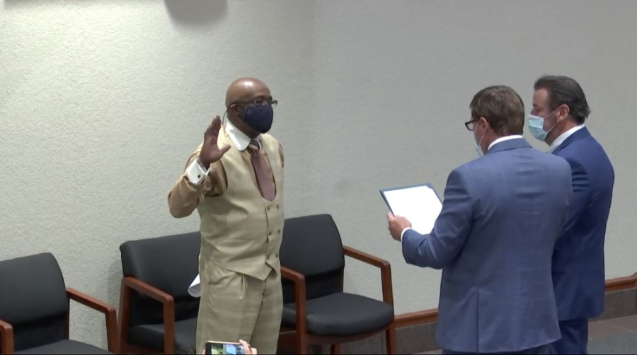 Chris Thornton is sworn into the McKinney City Council Dec. 1 to fill the vacancy for the District 1 seat. (Screenshot by Miranda Jaimes/Community Impact Newspaper)