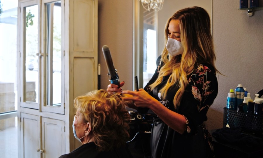 At The Salons at University Oaks, stylist Kristin DeMotta said her relationships with clients continually remind her why she pursued this career. (Kelsey Thompson/Community Impact Newspaper)
