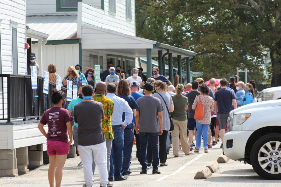 Voters line up outside Juergens Hall Community Center in Cypress on Oct. 14. (Shawn Arrajj/Community Impact Newspaper)