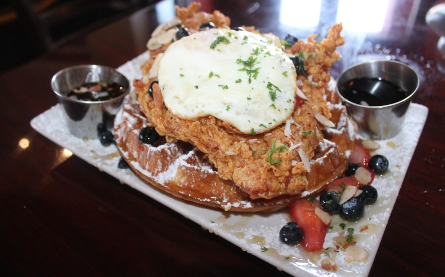 Chicken and waffles ($14.50): Cajun fried chicken breast brined in Cajun spices and cane syrup served over a Belgian waffle with shaved almonds, fresh berries and local honey.