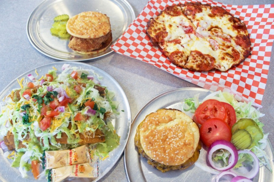 All items at Caroline's—A Healthy Eatery are sugar-free, gluten-free and keto, such as the copycat Chick-fil-A sandwich (top left), pepperoni pizza (top right), traditional pork tamales (bottom left) and the Angus cheddar burger (bottom right). (Hannah Zedaker/Community Impact Newspaper)