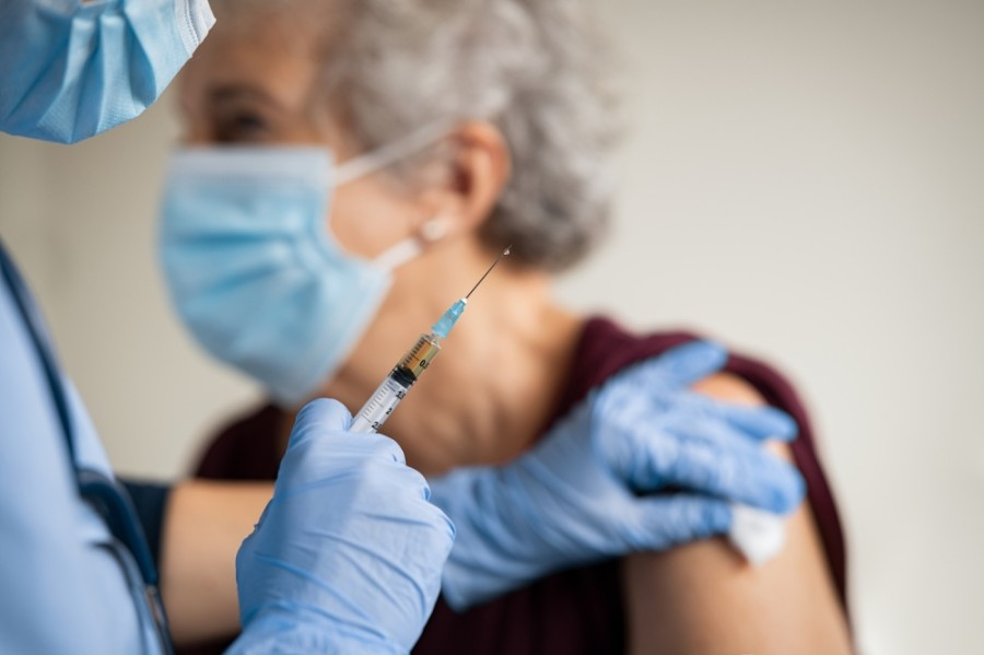 Photo of elderly woman receiving vaccine