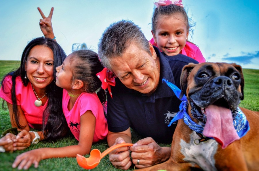 Manuel Buchanan, owner and operator of K9 PW Training and Boarding, is joined by his wife and two daughters when training dogs. (Courtesy K9 PW Training and Boarding)