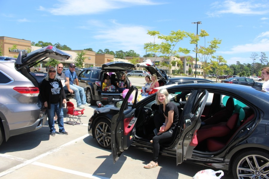 From her car in a parking lot April 15, Kingwood resident Sherrie Jennings celebrated her birthday surrounded by her family. (Kelly Schafler/Community Impact Newspaper)