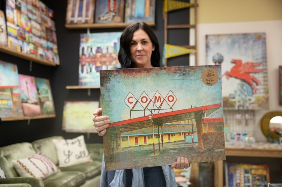Annie Holland, owner of Lone Chimney Mercantile, began making and selling her own landmark photo art after the birth of her daughter. (Liesbeth Powers/Community Impact Newspaper)