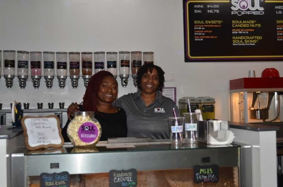 Soul Popped Owner De J. Lozada (right) stands with Assistant Manager Tiffany Nance. (Amy Rae Dadamo/Community Impact Newspaper)