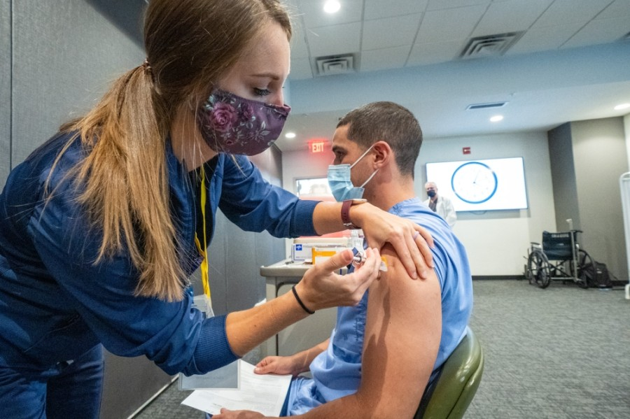 A health care worker receives a dose of the Pfizer vaccine administered by Ascension Seton. (Courtesy Ascension Seton)