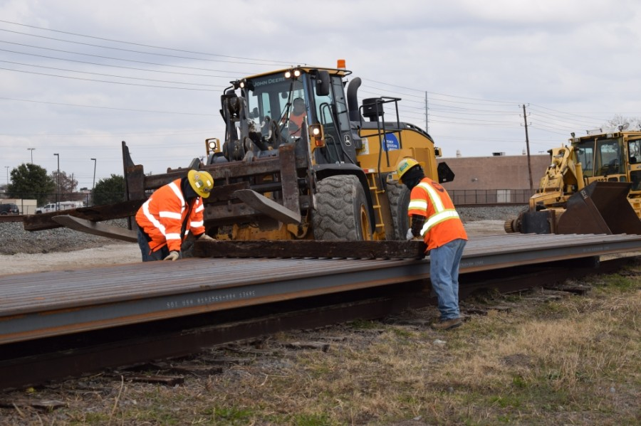 The 200 rail pieces—adding up to 16,000 feet of rail—were delivered east of Shiloh Road and unloaded near existing tracks, according to a Dec. 18 DART release. (Courtesy Dallas Area Rapid Transit)