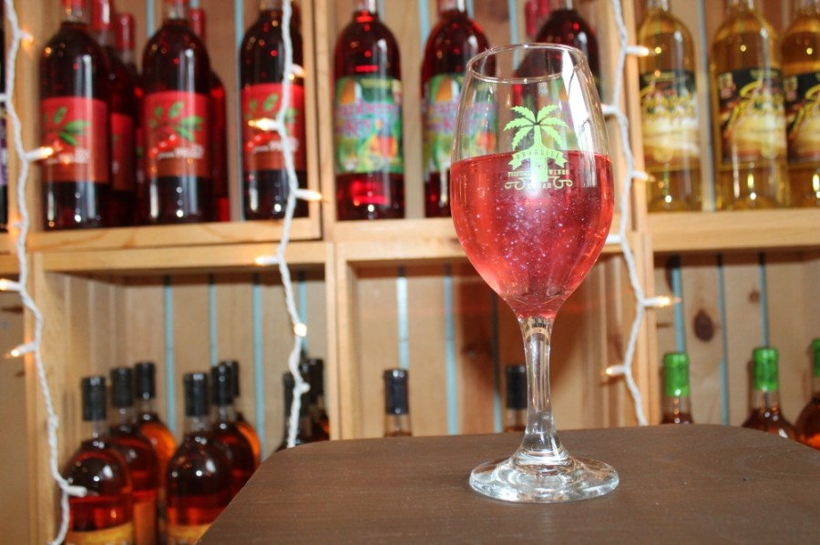 The watermelon tropical explosion ($9), which consists of watermelon wine with a watermelon cotton candy glitter bomb, is one of the wine bar's most popular items. (Colleen Ferguson/Community Impact Newspaper)