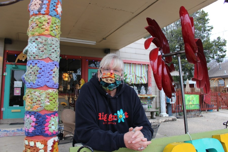 Tracey Collins, the owner of Diggin' It, said her friend knitted the decorations on her left. (Francesca D'Annunzio/Community Impact Newspaper)