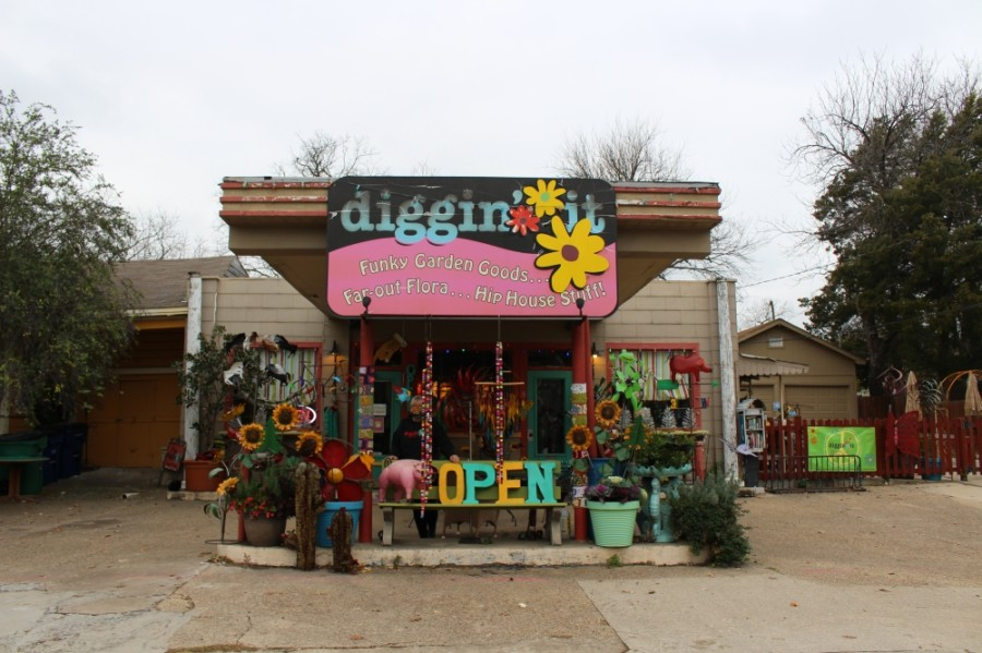 At first glance, Diggin' It's facade does not leave any trace of its past as a Greyhound bus station. However, with closer look, customers and passersby can see where the bus used to park in front of the store beneath the carport, which is now decked out in art and backyard decorations. (Francesca D'Annunzio/Community Impact Newspaper)