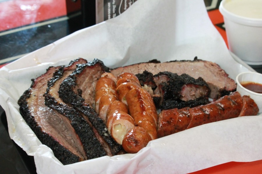 The Rusty Buckle BBQ Co. serves a plate with brisket, jalapeno cheese sausage, brisket burnt ends and black pepper sausage ($18). (Andy Li/Community Impact Newspaper)
