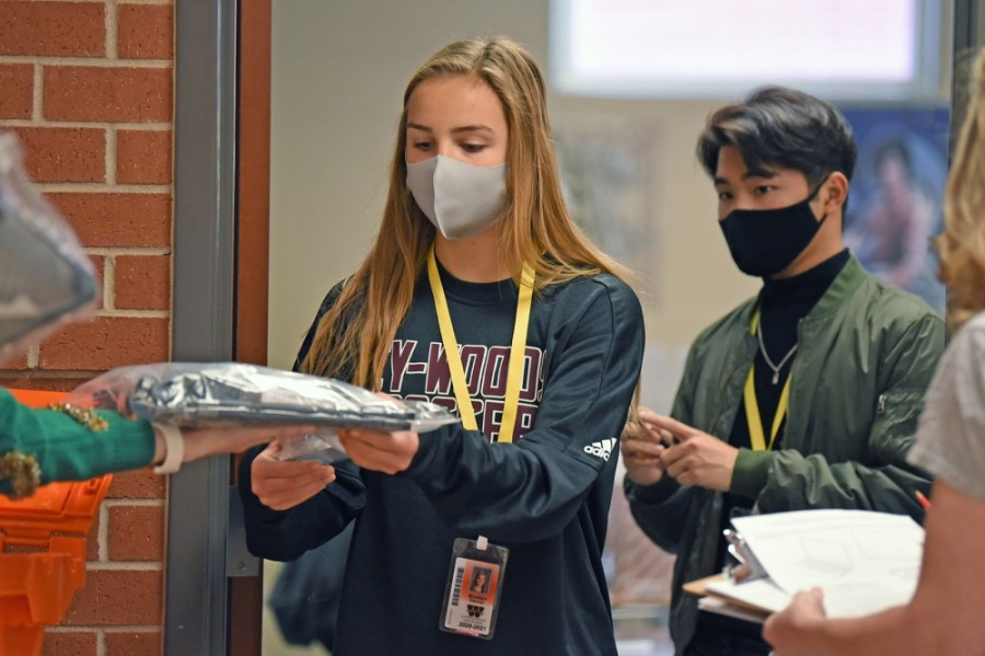 A Cypress Woods High School student receives a Chromebook in December. (Courtesy Cy-Fair ISD)