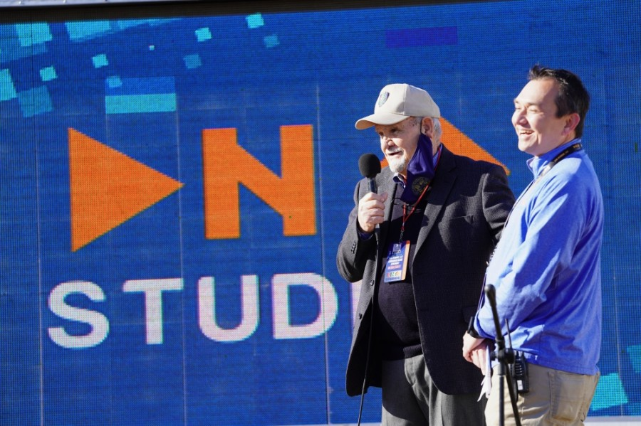 Humble Mayor Merle Aaron speaks to a crowd while CEO of DNA Studios Sam Schrade smiles during the groundbreaking ceremony. (Courtesy DNA Studios LLC)