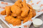 Known for its fresh, all-natural wings and sandwiches, the eatery boasts 18 signature sauces and six dry rubs for its classic-style wings, boneless tenders and thigh wings. (Courtesy Wing It On)
