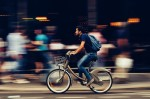 Man riding bike in city