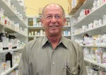 Scott Palmer, owner of Roanoke Pharmacy and Gift Shop, opened his business in 1999 after leaving the corporate world. (Sandra Sadek/Community Impact Newspaper)