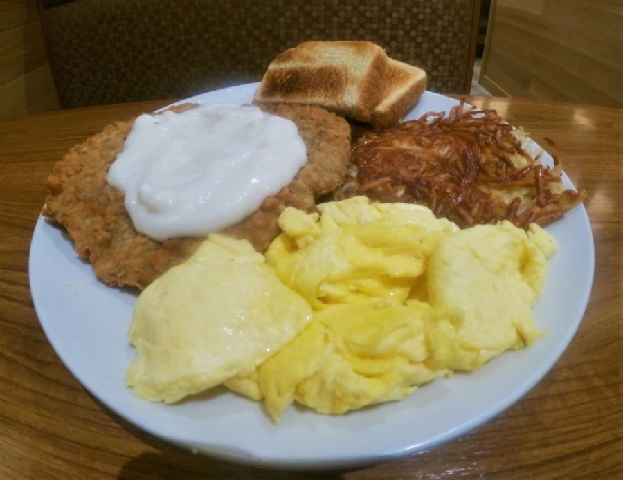 Chicken-fried steak and eggs ($11.99) are served with hash browns and Texas toast. (Courtesy The Cottage)