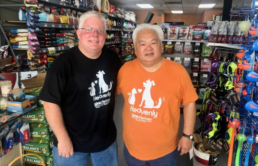 Jeff Manley (left) and Jusak Yang Bernhard own both Wag Heaven locations, the second of which opened downtown in 2020. (Sally Grace Holtgrieve/Community Impact Newspaper)