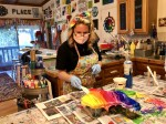 Art Barn ATX owner Amber Gordon uses resin on a project. (Sally Grace Holtgrieve/Community Impact Newspaper)