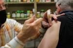 Scott Palmer administers a COVID-19 vaccine shot to a Roanoke police officer. (Sandra Sadek/Community Impact Newspaper)