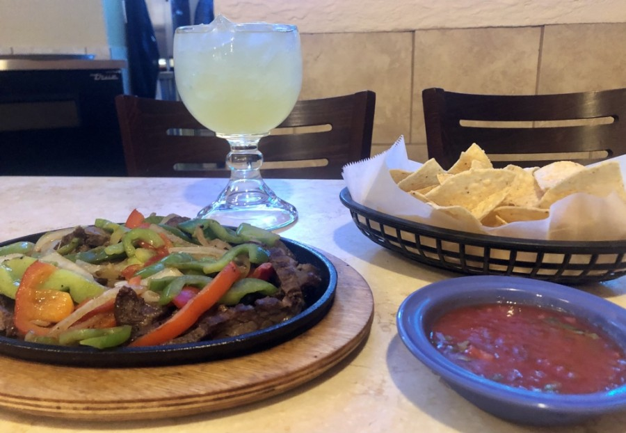 Steak fajitas are a popular menu item and are shown here with chips, salsa and a margarita. (Sally Grace Holtgrieve/Community Impact Newspaper)