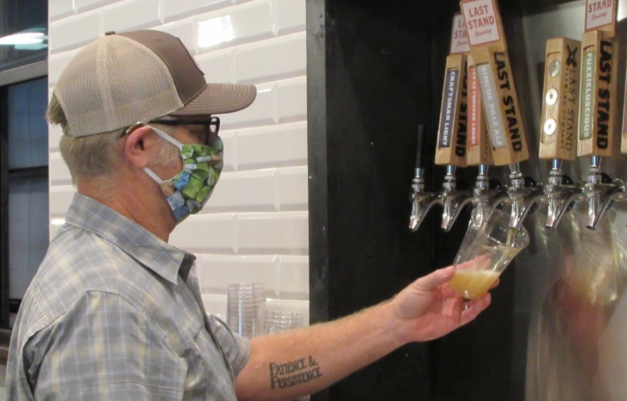 Last Stand Brewing Co. owner Jim Sampson pours a beer at the business's new South Austin brewery.  (Nicholas Cicale/Community Impact Newspaper)