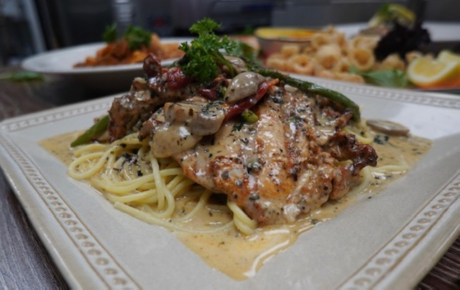 The Chicken Dam Bianca ($15.99) features mushrooms, sun-dried tomatoes and asparagus in a creamy sauce. (Courtesy Bella Italia Ristorante)