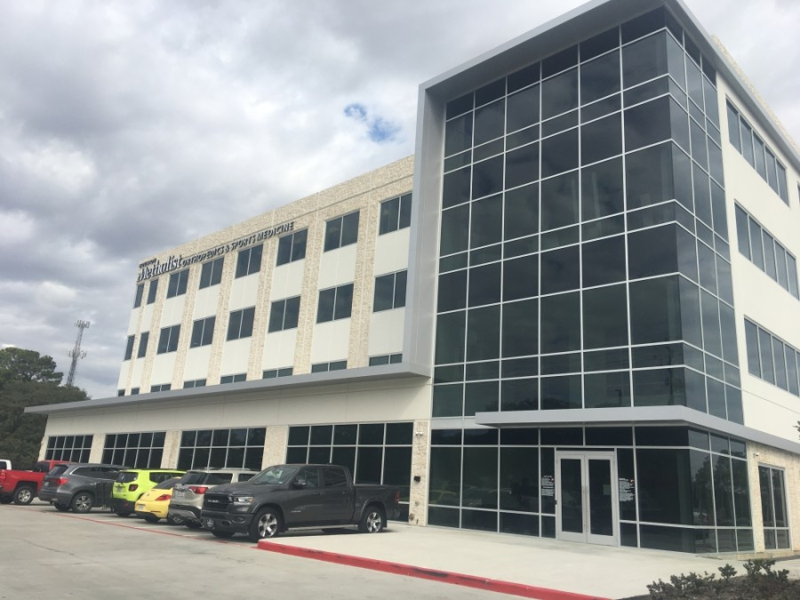 The four-story building on South Friendswood Drive will house medical practices, a law firm, a research company and more. (Haley Morrison/Community Impact Newspaper)