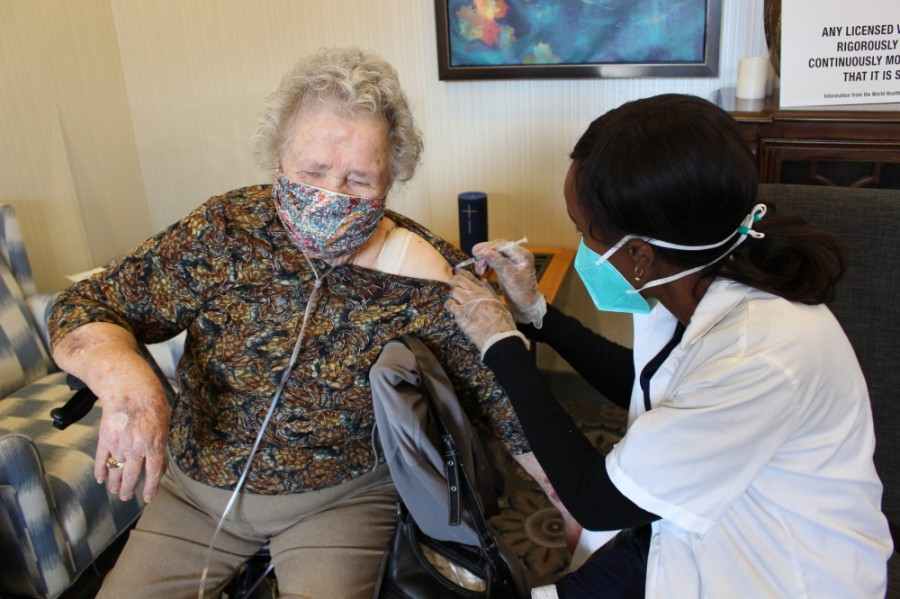Wanda Yates, a resident of Parkview senior care in Frisco, received her first dose of the COVID-19 vaccine on Jan. 16 from CVS Pharmacy employee Catherine Njehu. (Francesca D'Annunzio/Community Impact Newspaper)